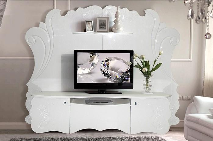 Тумба под телевизор Невеста КМК 0389Тумбы под телевизор<br>Размер: 2400х1850х959<br><br>Материалы: ЛДСП, Рамка МДФ, кромка ПВХ глянцевая<br>Полный размер (ДхВхГ): 2400х1850х959<br>Комплектация: Ручки с кристаллами в металлической оправе<br>Цвет: Белый, Белый металлик<br>Примечание: Доставляется в разобранном виде<br>Изготовление и доставка: 15-25 дней<br>Условия доставки: Бесплатная по Москве до подъезда<br>Условие оплаты: Оплата наличными при получении товара<br>Доставка по МО (за пределами МКАД): 35 руб./км. Доставка за МКАД, за пределы трассы А-107 (ММК)<br>Доставка в пределах ТТК: +1000 руб. Доставка в центр Москвы осуществляется ночью, с 22.00 до 7.00 утра<br>Подъем на грузовом лифте: 3% от стоимости изделия<br>Подъем без лифта: 1,5% от стоимости изделия за 1 этаж<br>Сборка: 10% от стоимости изделия. Выезд сборщика за МКАД 30 руб./км<br>Гарантия: 18 месяцев<br>Производство: Беларусь<br>Производитель: КМК